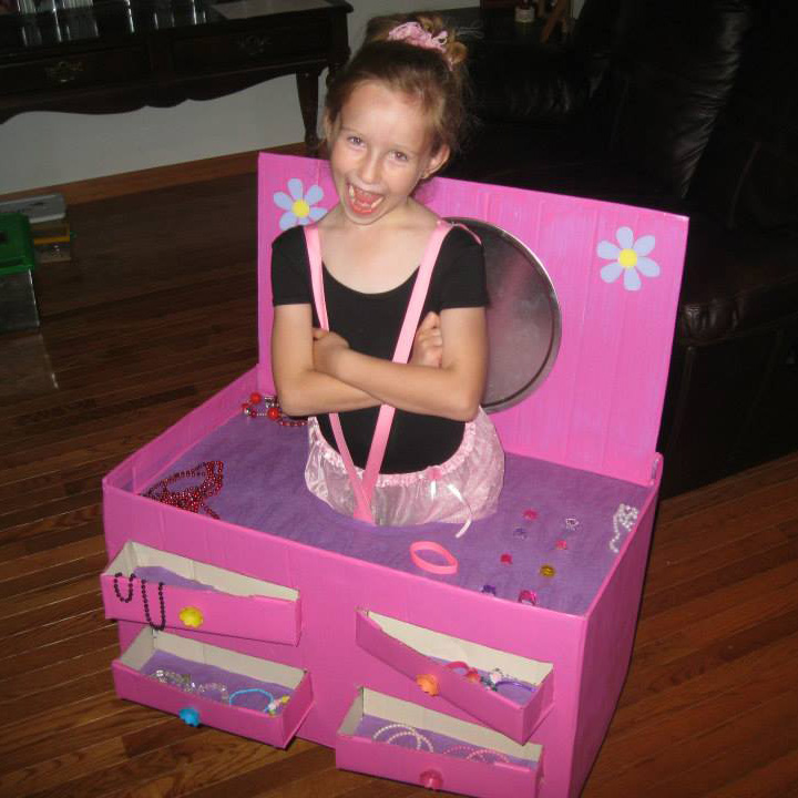 ballerina in a jewelry box costume